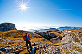 Hikers looking at view, Hochschwab mountain range, Styria, Austria