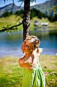 Young woman at lake Duisitzkar, Styria, Austria