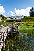 Guests on sun terrace near Duisitzkarsee lodge, lake Duisitzkar, Styria, Austria