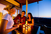 Young people drinking white wine on a terrace, Gamlitz, Styria, Austria