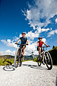 Two mountain bikers on a gravel road, Duisitzkar, Planai, Styria, Austria