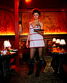 USA, California, Los Angeles, portrait of waitress holding tray with glass of cocktail Bar Marmont.