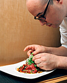 USA, California, Los Angeles, chef plating steak tartar at CUT Restaurant.