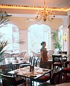 CHINA, Macau, Macau, waitress standing in Bella Vista Cafe