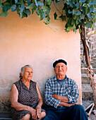 CROATIA, Hvar, Dalmatian Coast, Ivan Tomisic and Vica Tomisic sitting outside house their house in Hvar Island.