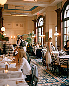 USA, Nevada, Las Vegas, people sitting in Bouchon Restaurant.