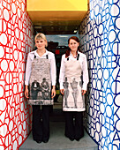 RUSSIA, Moscow, young waitresses at the front door of the Book Cafe.