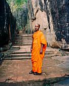 SRI LANKA, Asia, portrait of a Monk man standing at Sigiriya