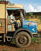 SRI LANKA, Asia, portrait of a driver sitting in truck