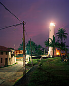 SRI LANKA, Asia, Galle, view of a lighthouse at Galle with palm trees