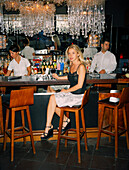 TURKEY, Istanbul, portrait of young female sitting at bar counter in Ulus 29 Restaurant