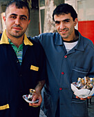 TURKEY, Istanbul, portrait of mid adult men holding tea cups