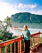 USA, Alaska, Redoubt Bay Lodge, woman watching a float plane take off