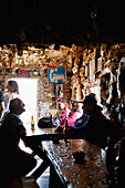 ALASKA, Homer, fishermen drink beer at the Salty Dawg Saloon after a long day of fishing, Land's End, the Homer Spit