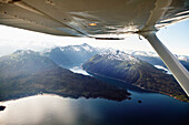 ALASKA, Homer, aerial view of Kachemak Bay State Park and Wilderness, Kenai mountains and Sadie Cove