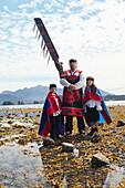 ALASKA, Sitka, Sheeta Kwan Naa Kahidi dancers in traditional costume, Nathan Howard with his son Jonathan and daughter Alice, Sitka Sound