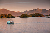 ALASKA, Sitka, a fishing boat makes it's way to the Sitka Harbor, Crescent Bay, Sitka Sound