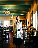 USA, Arizona, waitress in dining room of La Posada Hotel, Winslow