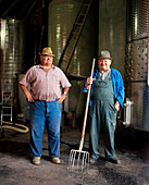 AUSTRIA, Joie, winemakers Willi Wetschka and Andre stand in front of their wine Vats, Golouborger Wine, Burgenland