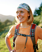 USA, California, close-up of a happy young woman backpacking, Marin Headlands