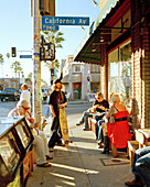 USA, California, people convene in front of Abbot's Habit Cafe in Venice Beach at the intersection of Abbot Kinney Boulevard and California Avenue