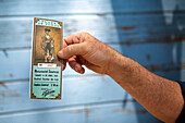 USA, California, Escalon, Dennis Borba holds a ticket from a bullfight he fought in Zacatecas