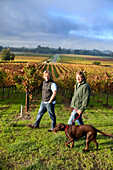 USA, California, Gundlach Bundschu Winery, fifth and sixth generation vineyard owners Jim and his son Jeff Bundschu walk through the vineyard with Ruby