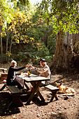 USA, California, Sonoma, Wendy and Bob Smithers picnic at the Buena Vista Carneros winery