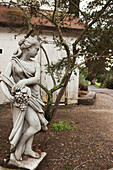 USA, California, a statue and the exterior of the tasting room at the Bartholomew Park winery and vineyard