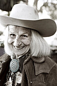 USA, California, Malibu, portrait of Mildred Millie Decker at her ranch home up in the hills in Decker Canyon, 75 year resident of Malibu (B&W)