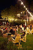 USA, California, Malibu, friends socialize and drink wine in the Malibu Hills at Saddleback Ranch