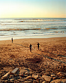 USA, California, San Francisco, surfers walk to the water at Ocean Beach, The Pacific Highway, HWY 1