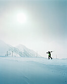 CANADA, skier walking with skiis at the top of the mountain, Kicking Horse Ski Resort