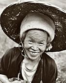 CHINA, portrait of Rice Farmer, smiling senior woman (B&W)