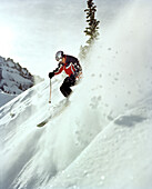 USA, Colorado, man skiing in powder on steep slope, Telluride