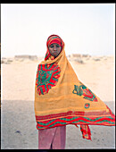 ERITREA, Village of Saroita, portrait of an Afar girl outside of her home