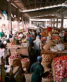 ERITREA, Asmara, people sell and buy produce at an open market in Asmara