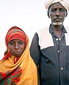 ERITREA, Saroita, portrait of an Afar Mr. Bedri and his daughter in front of their home in the small village of Saroita