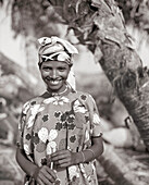 ERITREA, Beilul, a young Afar girl tends to her livestock in Dad Village (B&W)