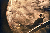 FIJI, surfer duckdiving underwater, Southern Lau Islands (B&W)