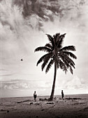 FIJI, Northern Lau Islands, a father and son wander across a small remote island to go fishing (B&W)