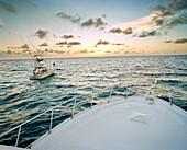 USA, Florida, fishing boats on sea at sunrise, Islamorada