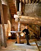 FRANCE, Burgundy, Michael Laroche in his old grape pressing room, Chablis