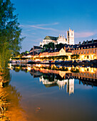 FRANCE, Burgundy, Abaye Saint Germain reflecting on river at night, Auxerre