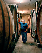 FRANCE, Montigny-les-Arsures, Arbois, Jacques Puffeney stands in his barrel room, Jacques Puffeney Winery, Jura Wine Region, Vin Jaune