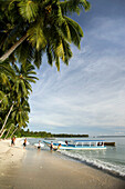 INDONESIA, Mentawai Islands, Kandui Surf Resort, surfers loading a boat to go surfing for the day