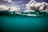 INDONESIA, Mentawai Islands, Kandui Surf Resort, half underwater and half sky and clouds, Indian Ocean