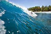 INDONESIA, Mentawai Islands, Kandui Surf Resort, young man surfing on wave, Nupussy