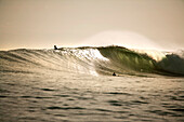 INDONESIA, Mentawai Islands, Kandui Resort, surfing at sunset, Bankvaults