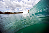 INDONESIA, Mentawai Islands, Kandui Resort, man surfing on a wave at a break called Beng Beng